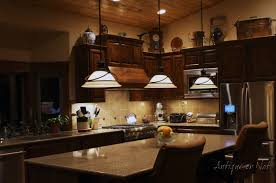 Decorating Above Kitchen Cabinets Decorating Above Kitchen Cabinets Dark Chimney White Hood Gold