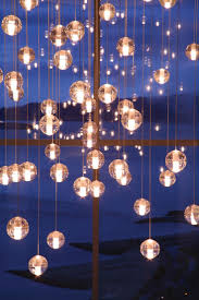 bubble chandelier i bet i could make these using the glass ball idea since i know how to wire a pendant lamp many little lamps on one circuit or battery