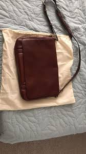 fossil cognac leather messenger bag retails for 300
