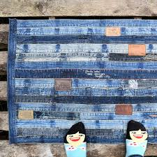 tutorial for a diy denim rug made from repurposed jeans waistband ikea no sewing