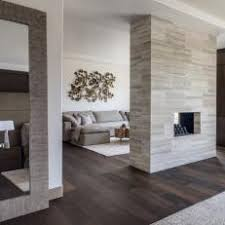 Chic, Open Living Room With Double-Sided Fireplace