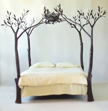 Adorable bed frame design with tree branches and a birds nest  @istandarddesign