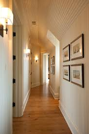 mirror wall sconces for candles hall traditional with white wood slats white walls white walls