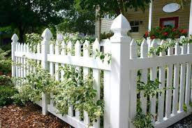 Small Garden Fencing A Vinyl White Picket Fence In Front Of A Small