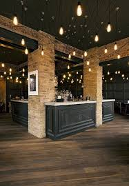 industrial interior lighting. like the black ceiling and wood with industrial type lighting very masculine also brick interior r