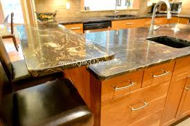 kitchen countertop raised island bar with black and gold granite and natural fir cabinets