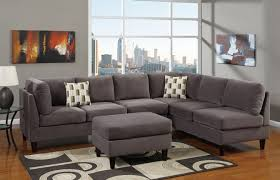 modern living room area with grey suede l shaped sectional living spaces couches catalina black brown square rug design and wrought iron glass top small
