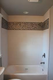 porcelain shower with glasetal mosaics