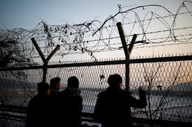 photo essay tag newshour people look toward through a barbed wire fence near the demilitarized zone separating