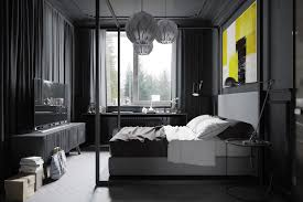 the bedroom is unmistakably masculine using a dark gray color palette to make everything feel bedroom ideas dark
