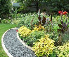 garden paths easy. keeping turf grass from encroaching in your garden beds is a lot easier when you install paths easy