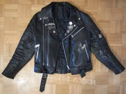 black leather jacket with metal pins ons iron maiden patch