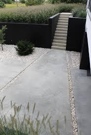 very cool concrete pavers + gravel #modernpavers #moderndriveway  www.cfa-online.