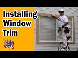 exterior window trim install. installing new window trim on the exterior of a house. install