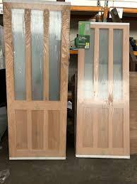 2 new oak veneer glazed interior doors b q