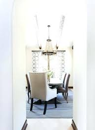 vaulted dining room ceiling with scalloped wood bead chandelier regina andrew mini diva