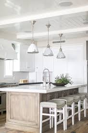 White Kitchen Lighting White Kitchen Design With Light Wooden Cabinets And Detailed