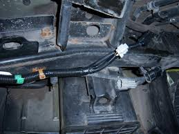 photo installing oem 7 min trailer wiring harness on a 2005 after inserting all 3 brown wire clips the 2 connectors are lined up to be plugged into the matching color connectors on the vehicle side