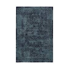 overdyed blue tribal area rug