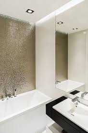 metallic bathroom accessories. this apartment will inspire you to go bold with your decor metallic bathroom accessories