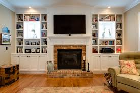 bookcases built out around windows wando view home in daniel island sc by jacksonbuilt custom homes like the grid on the shelves