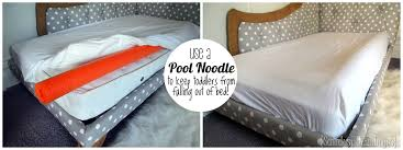 use a pool noodle under the mattress pad to create a lip and keep