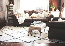 brown rugs for living room thoughts from chic living room makeover finding the perfect rug dark