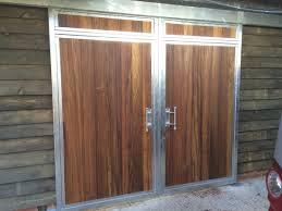 external sliding barn door in hardwood with galvanised pelmet