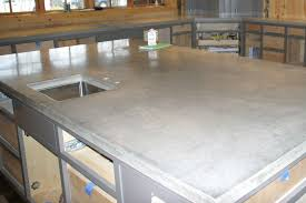 party size concrete island in a huge concrete kitchen more