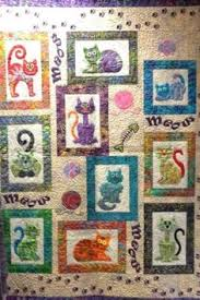 Cat's Meow by Angie Steveson of Lunch Box Quilts, quilted by ... & Cat's Meow by Angie Steveson of Lunch Box Quilts, quilted by Jessica Jones.  Original design, now a pattern. Exhibited at the 2014 Arizona Quilter… Adamdwight.com