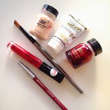 paint brush or old makeup brush that you d be happy to throw away after grey and black eyeshadows red lipstick lip liners lip glosses etc