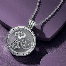 large pandora floating locket chain locket shown with petite charms