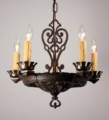 this is a splendid antique five light chandelier in cast iron dating from the 1920 s the chandelier begins with a hammered faux riveted canopy