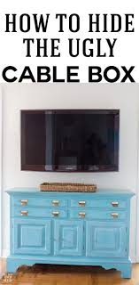 how to hide a cable box and the wires coming from a wall mounted tv