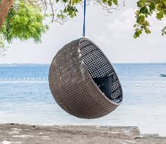swing chair set up hanging from a tree