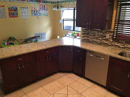 Granite Countertops And Backsplash Pictures Extraordinary Giallo Ornamental Granite Countertops In Kitchen With Backsplash Tiles