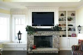 hanging television over fireplace over mantle mount television over fireplace