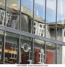 Stock Photo Of Glass Office Windows Reflecting Distorted Building