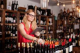 Female small business owner using tablet computer while working in wine shop  - CAVF15901 - Cavan Images/Westend61