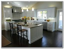 white kitchen cabinets with dark floors white shaker kitchen cabinets dark wood floors off white kitchen