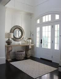 open front door welcome. Entry Way Ideas West Beach House Molly Frey White Front Door Paned Glass Dark Wood Floors Foyer Console Table Lamp Mirror Basket Arched Doorway Entryway Open Welcome !