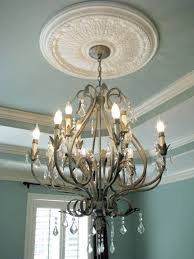 medium wrought iron chandelier with crystals and ceiling medallion in office