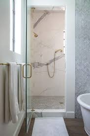 walk in shower with large carrera hex marble floor