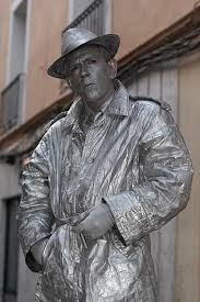 i would see living statues in the central park and in the times square subway station