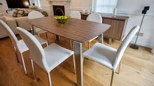 6 8 seater extending dining table and white dining chairs
