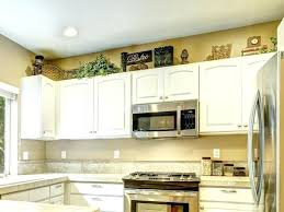 decorating above kitchen cabinets.  Decorating How To Decorate Above Kitchen Cabinets Decorating New  Ideas For Throughout Decorating Above Kitchen Cabinets