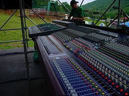 concert speakers system. a yamaha pm4000 and midas heritage 3000 mixing console at the front of house position an outdoor concert. concert speakers system