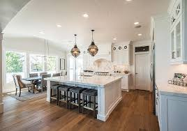 Do away with kitchen isolation. Lighten up the area. Open layouts are here  to