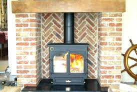 log burner fireplace with gas lighter pipe wood surrounds