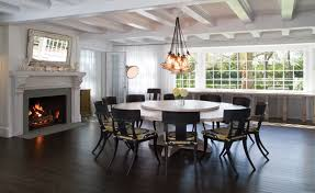 this is an example of an expansive beach style open plan dining in new york with